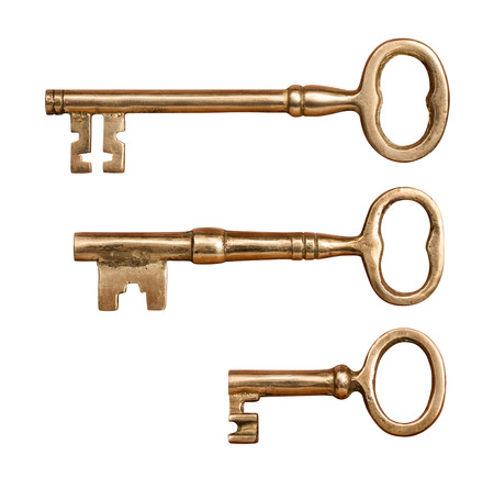 antique keys: Three Antique Brass Keys isolated on white with a clipping mask.