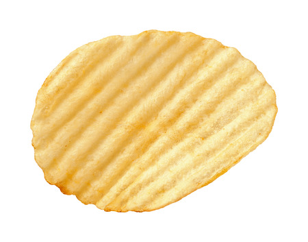 A single wavy potato chip with ridges, sometimes called ruffles, isolated on a white background. Stock Photo