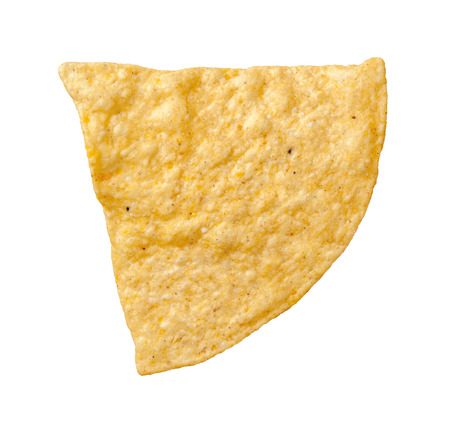 A single tortilla chip isolated on a white background. Tortillas are a salty snack associated with parties, and watching sporting events, often served with salsa dip. It is thin flatbread made from finely  ground wheat flour and falls into category of one