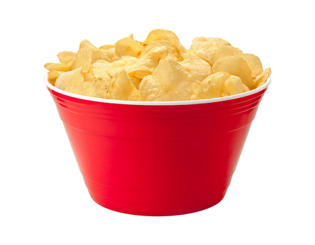 they are watching: Potato chips in a red plastic party bowl. Potato chips are a salty snack associated with parties, and watching sporting events, often served with salsa dip. They fall into the category of one of Americas favorite junk foods. This snack is notorious for be Stock Photo