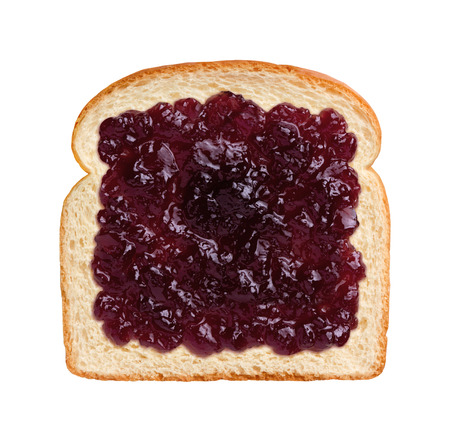 Aerial view of a single slice of bread with grape jelly, or jam.