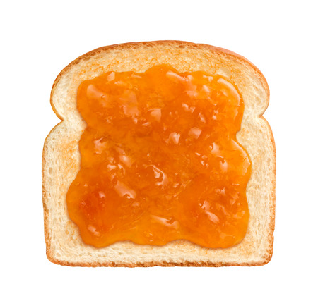 Aerial view of Apricot Preserves on a single slice of lightly toasted white bread. Isolated on white.