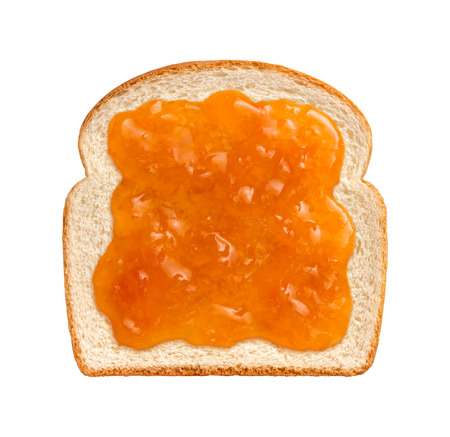 apricot jam: Apricot Preserves on a Single Slice of white bread isolated on a white background.