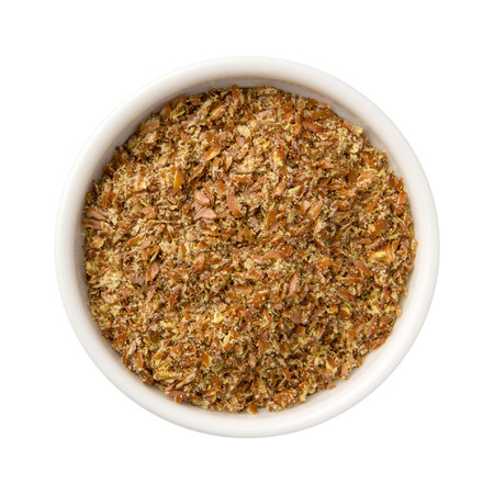 flaxseed: Aerial view of whole ground Flax Seed Meal in a white ceramic bowl. The subject is isolated on white and includes a clipping path.