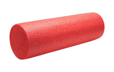 Red High Density Foam Exercise Roller isolated on white.