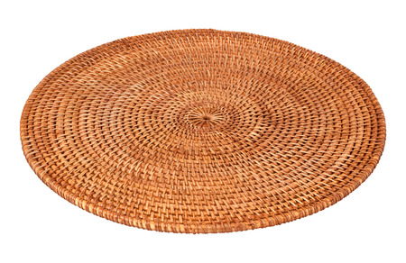 rattan mat: Round Woven Place mat isolated on white. The image is in full focus, front to back.