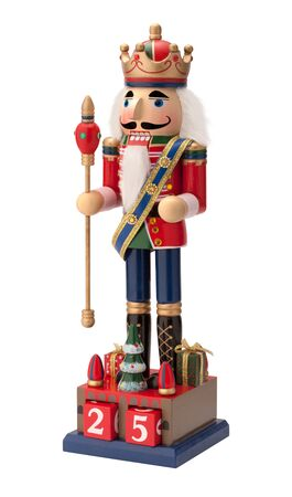 scepter: Antique Christmas Royal Nutcracker holding a scepter. He wears a crown and sash with his uniform and is isolated on a white background.