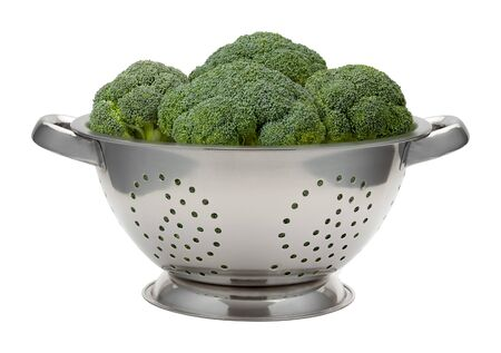 stainless: Fresh Broccoli in a Stainless Steel Colander. This healthy vegetable is rich in nutrition. The image is a cut out, isolated on a white background.
