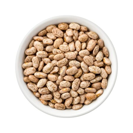 spotted: Overhead View of Pinto Beans in a Ceramic Bowl. Rich in fiber and nutrition. The image is a cut out, isolated on a white background, with a clipping path.