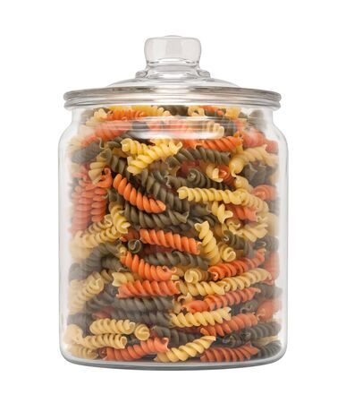rotini: Rainbow Rotini Pasta in a Apothecary Jar. The image is a cut out, isolated on a white background, with a clipping path. Stock Photo
