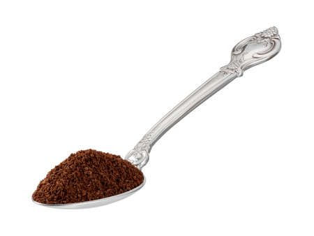 flatware: Scoop of Ground Coffee in a Spoon. The image is a cut out, isolated on a white background. Stock Photo