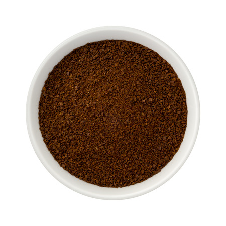 Ground Coffee in a Ceramic Bowl. The image is a cut out, isolated on a white background, with a clipping path.  on a transparent background.