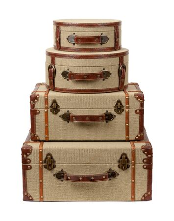 vintage background: Four Stacked Deco Burlap Suitcases. The image is a cut out, isolated on a white background. Stock Photo