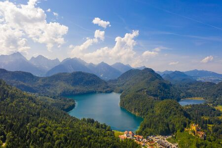 Aerial view on Alpsee lake and Hohenschwangau Castle, Bavaria, Germany. Concept of traveling and hiking in German Alps
