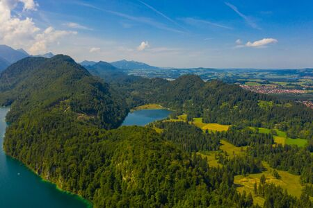 Aerial view on Alpsee lake, Bavaria, Germany. Concept of traveling and hiking in German Alps