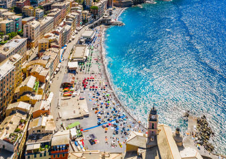 Aerial view of Camogli. Colorful buildings near the ligurian sea. View from above on the public beach with azure and clean water. Archivio Fotografico
