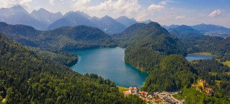 Aerial view on Alpsee lake and Hohenschwangau Castle, Bavaria, Germany. Concept of traveling and hiking in German Alps.