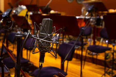 Microphone with a stand close up. Instruments of the Orchestra in philharmonia, Prague, 15.11.2019