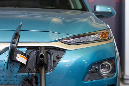 Charging an electric or hybrid PHEV car with the power cable supply plugged in