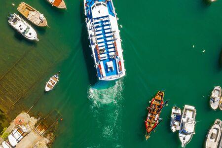 Cruise ship at harbor. Aerial view of beautiful yacht and boats in marina bay.