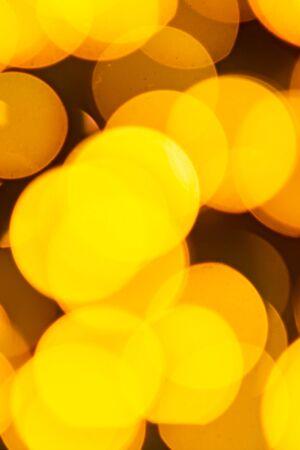 Golden yellow abstract background with bokeh defocused blurred lights. Foto de archivo - 138396993