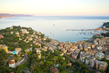Sunset in italian riviera. Top view of a small town with traditional italian houses close to the coastline of Ligurian Sea, Santa Magdalena Ligure near Portofino. 免版税图像