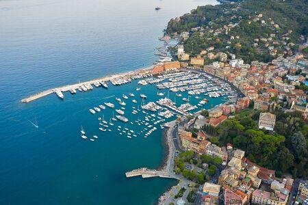 Panoramic view of a harbor in Ligurian Sea, Santa Margherita Ligure, Italy. Colorful houses on a seashore