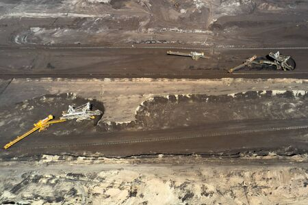 Aerial shoot of quarry with heavy bucket wheel excavators mining a coal. Heavy industry concept.