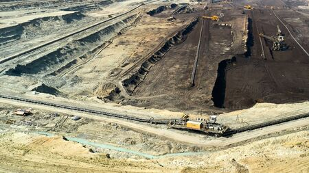 Panoramic view of a quarry with huge machine, bucket wheel excavator mining a coal. Heavy industry