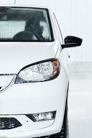 Water drops on a car after washing. Self service manual car wash concept