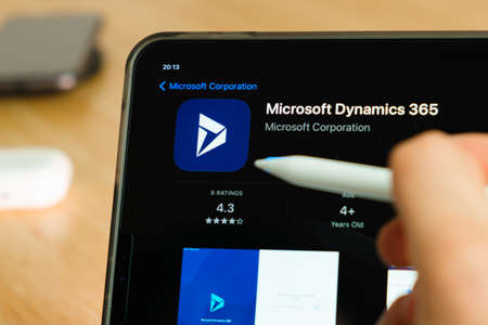 Microsoft dynamics 365 logo shown by apple pencil on the iPad Pro tablet screen. Man using application on the tablet. December 2020, San Francisco, USA.