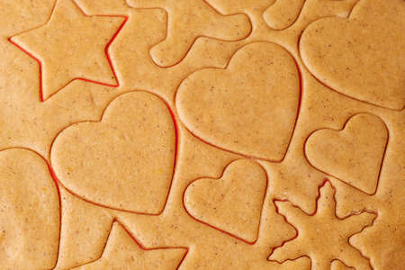 Unbaked cookies in the shape of heart and star for St. Valentines Day. Homemade pastry.