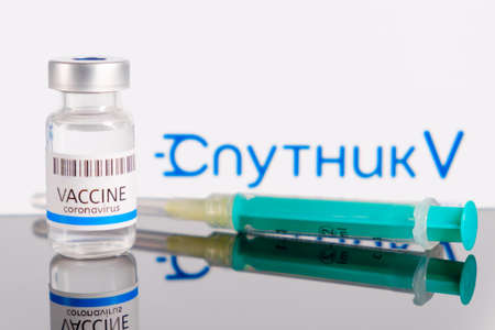 Sputnik V logo on the background of bottle or vial with vaccine and syringe for injection for prevention of coronavirus, SARS-COV-2, Covid-19, January 2021, San Francisco, USA