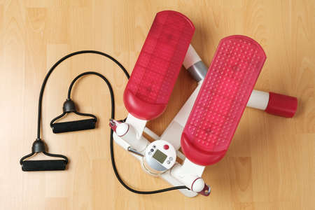 Fitness stepper or cardio training with digital display on the floor. Workout at home during pandemic and quarantine. Keep fit. Home gym equipment