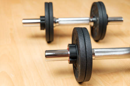 Dumbbells on the floor at home. Keeping fit during lockdown.