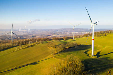 Panoramic view of wind turbines or wind mills in the field for electricity generation.