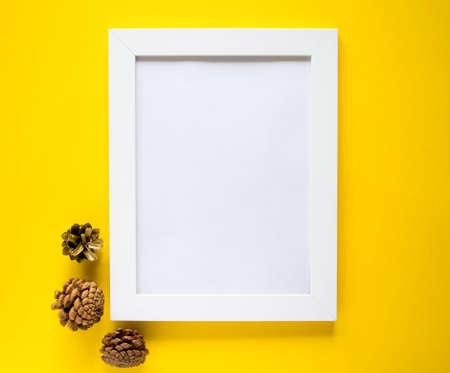 Holiday photo frame on isolated yellow background
