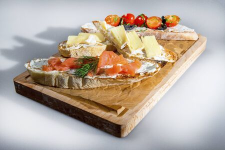 French Baguette Snacks With Salmon Cheese And Vegetables Stock Photo