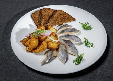 Russian Herring Snack With Baked Potatoes And Black Bread Croutons