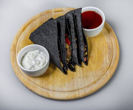 Black Tortilla Triangles With Vegetable Stuffing