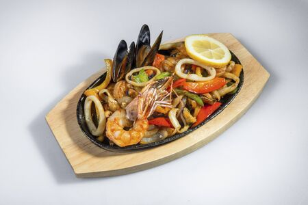 Mixed Fried Seafood On A Cast Iron Pan