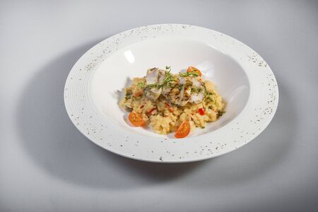 Fried Cod With Risotto Stock Photo