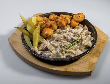 Beef Stef In Creamy Sauce With Baked Potatoes And Pickled Cucumbers