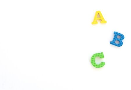 Multi-colored soft English letters A, B, C on white background. Back to school, teaching kids to write and read letters concept. Flat lay style, top view with copy space for your text. Stok Fotoğraf
