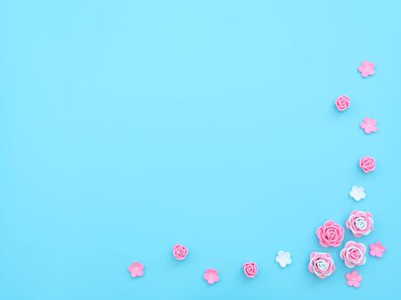 Pink and white flowers made of foamiran on blue background with beads. Mother day, Valentine day, Wedding, Birthday concept. Greeting or invitation card. Flat lay with copy space. 版權商用圖片
