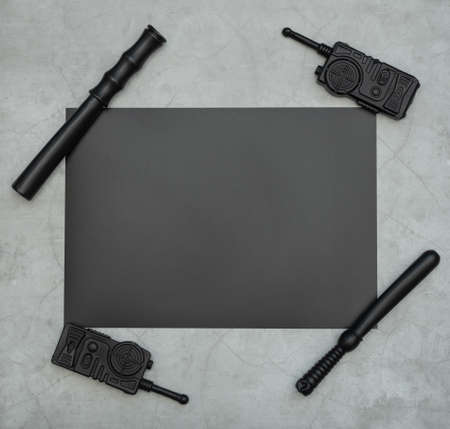 Policeman, detective or special agent accessories: radio stations, batons on gray background. Stop police brutality, racism and discrimination concepts. Black Lives Matter flat lay. 版權商用圖片