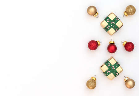 Christmas white background with two wrapped gift boxes with green ribbon and red and gold Xmas balls. New Year greeting card. Christmas, New Year concept. Flat lay style with copy space. Banque d'images
