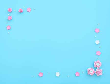 Pink and white flowers made of foamiran on blue background with beads. Mother day, Valentine day, Wedding, Birthday concept. Greeting or invitation card. Flat lay with copy space. Banque d'images