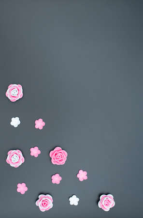 Pink and white flowers made of foamiran on black background. Mother day, Valentine day, Wedding, Birthday concept. Greeting or invitation card. Flat lay with copy space. Vertical card.