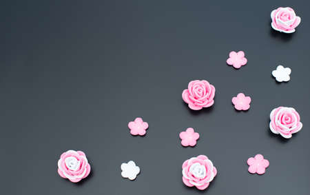 Pink and white flowers made of foamiran on black background. Mother day, Valentine day, Wedding, Birthday concept. Greeting or invitation card. Flat lay with copy space.